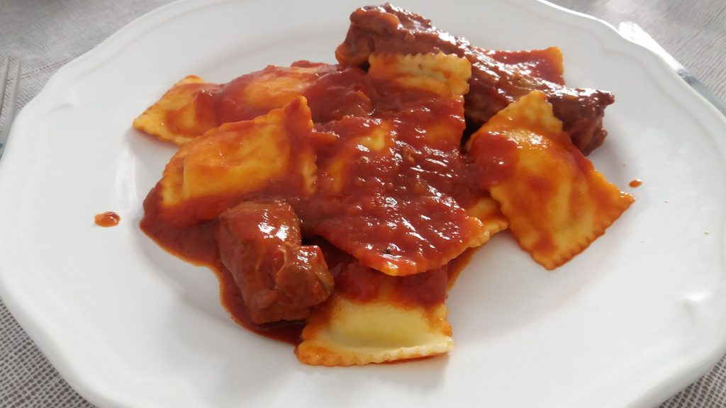 Ravioli with tomato and pork sauce